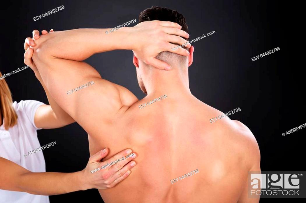 Stock Photo: Close-up Of A Physiotherapist Giving Shoulder Massage.