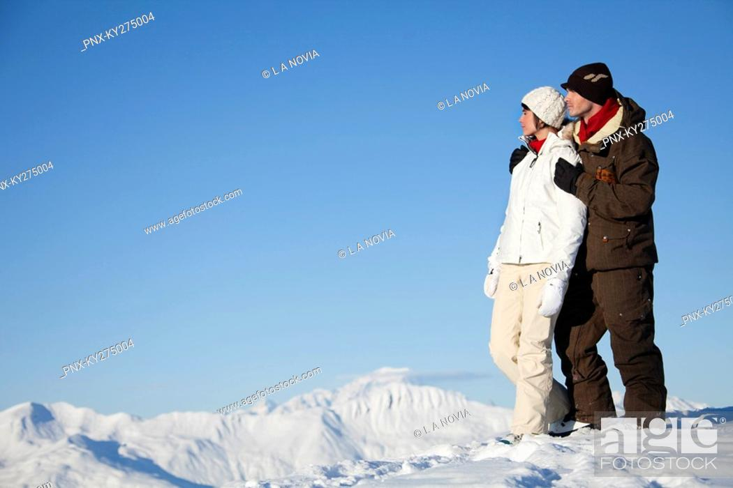 Stock Photo: Young couple embracing in snow.