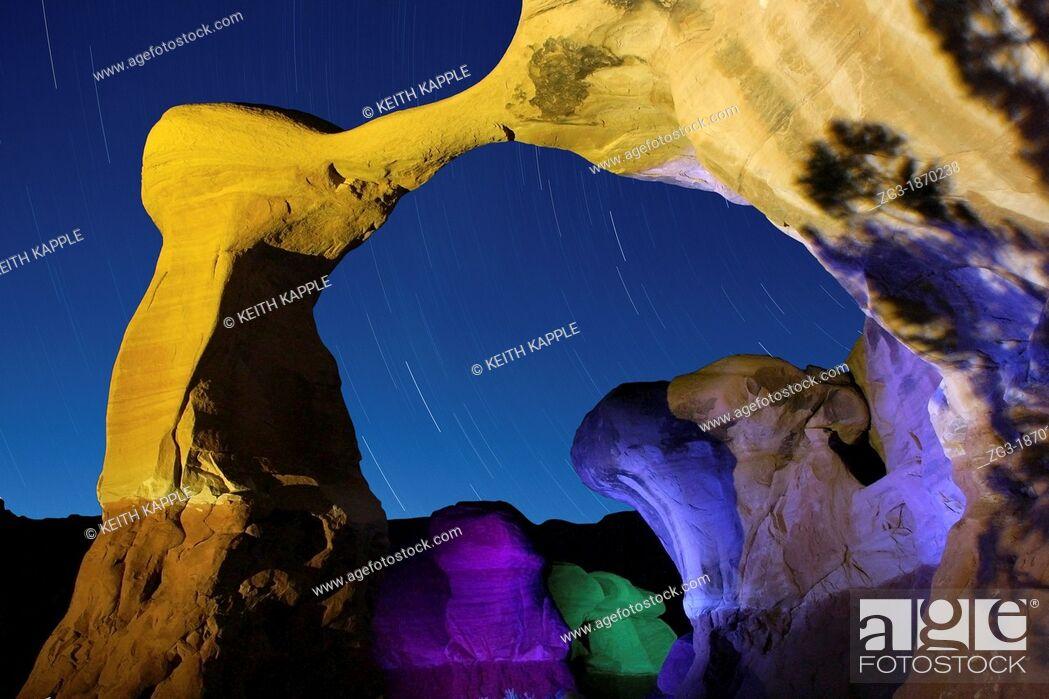 Stock Photo: Start trails, USA, Utah, Escalante Region, Devil's Garden, Metate Arch.