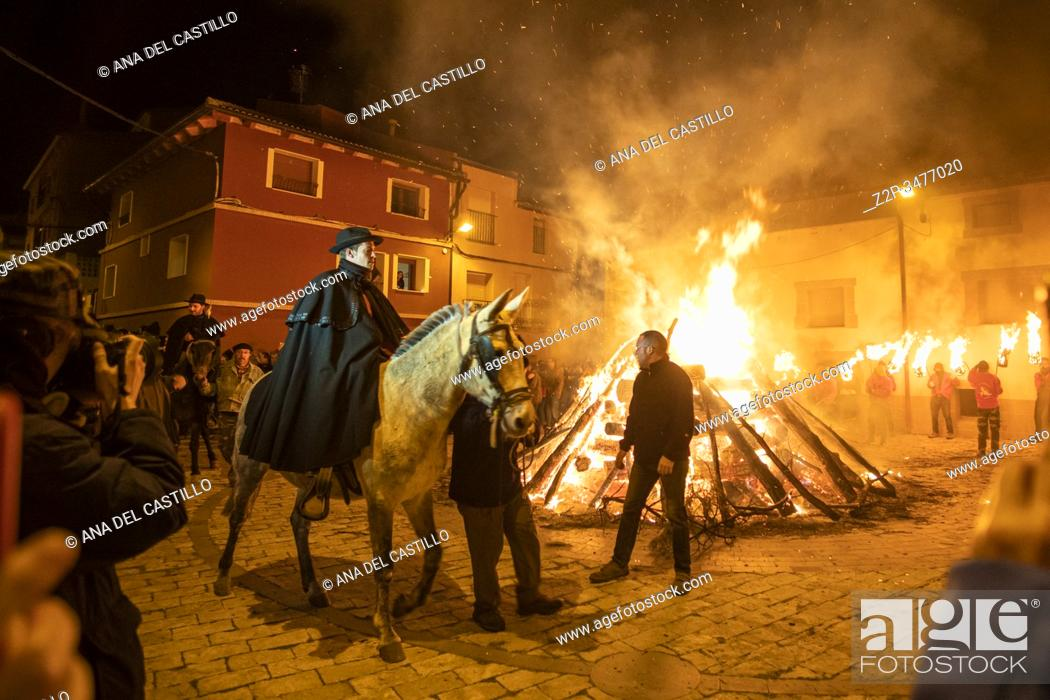 Stock Photo: ESTERCUEL TERUEL PROVINCE ARAGON SPAIN ON JANUARY 18, 2020: La Encamisada feast when men rides his horses through the fire in the traditional celebration of.