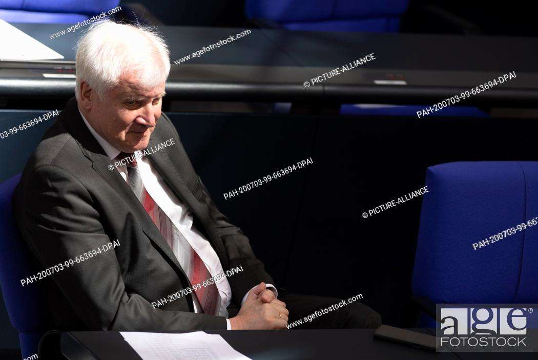 Stock Photo: 03 July 2020, Berlin: Horst Seehofer (CSU), Federal Minister of the Interior, sits in the German Bundestag during the plenary session.