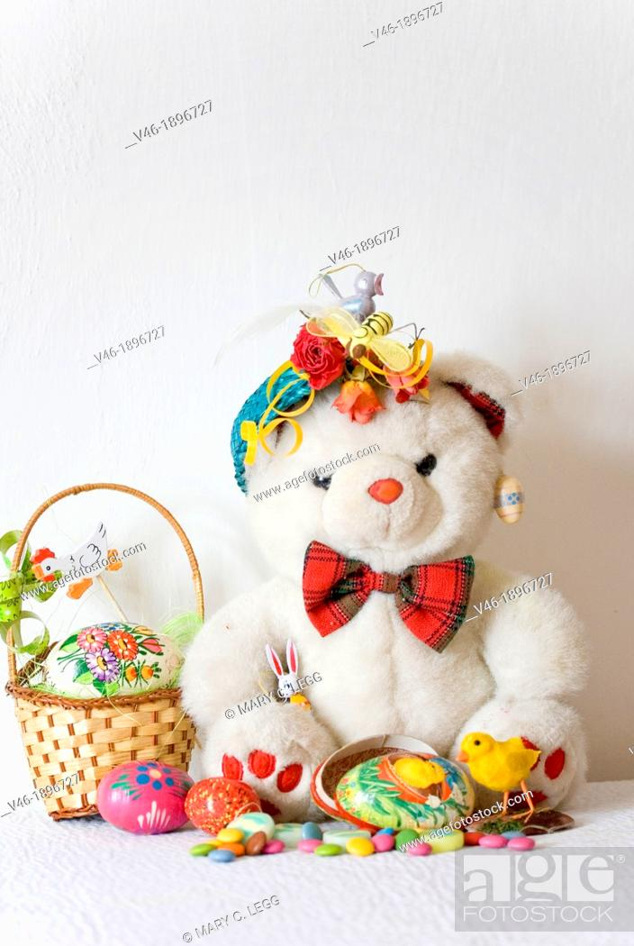 Stock Photo: White Teddy Bear with papier mache Easter Egg  Fatso the Bear has a papier mache Easter Egg filled with candies and Easter chick  Marzipan duck  Small Easter.