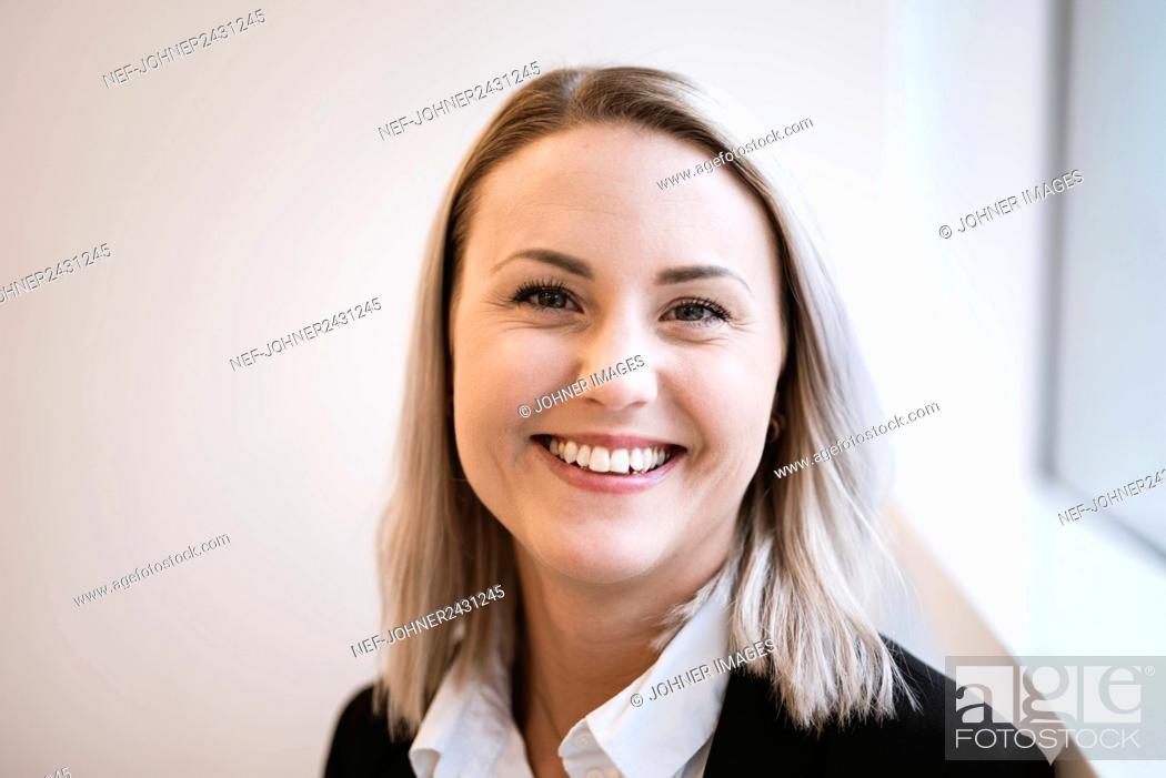 Stock Photo: Portrait of smiling woman.