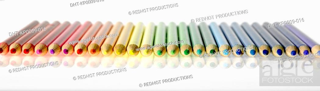 Stock Photo: Coloured pencils in a row.