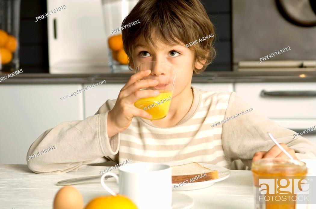 Stock Photo: Boy having breakfast.