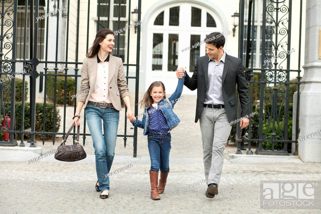 Stock Photo: Portrait of a girl walking with her parents.