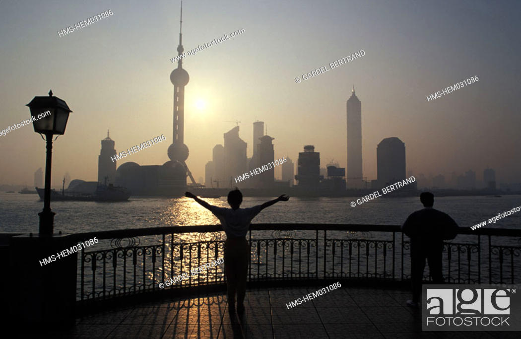 Stock Photo: China, Shanghai city, Taï Chi daily exercises on Bund at dawn.