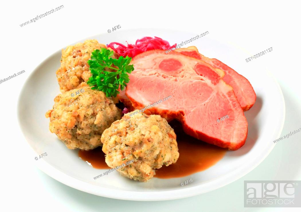Stock Photo: Smoked pork with Tyrolean dumplings and red kraut.