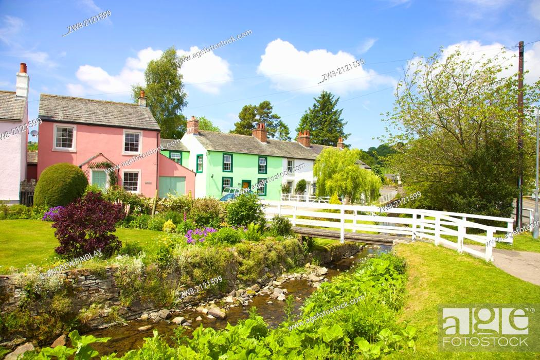 Stock Photo: Brightly coloured painted houses at Caldbeck, Lake District, Cumbria, England, United Kingdom.
