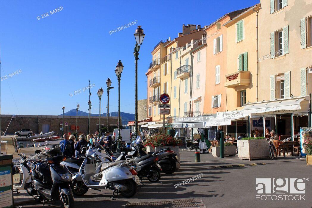 Imagen: France , Cote D'Azur, , St Tropez, Harbourside Cafes and motor scooters. Zoe Baker.