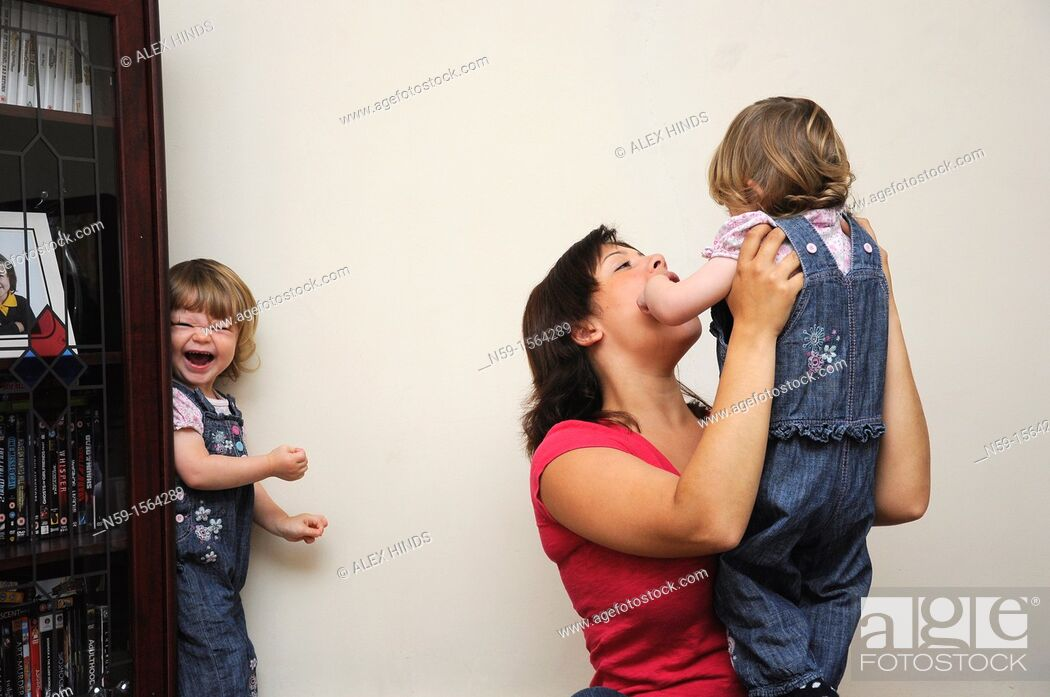 Stock Photo: Mother and twin girls at home.