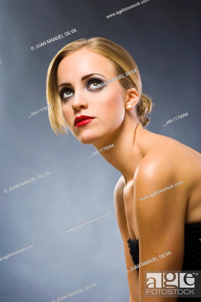 Stock Photo: Blonde woman looking up, portrait.