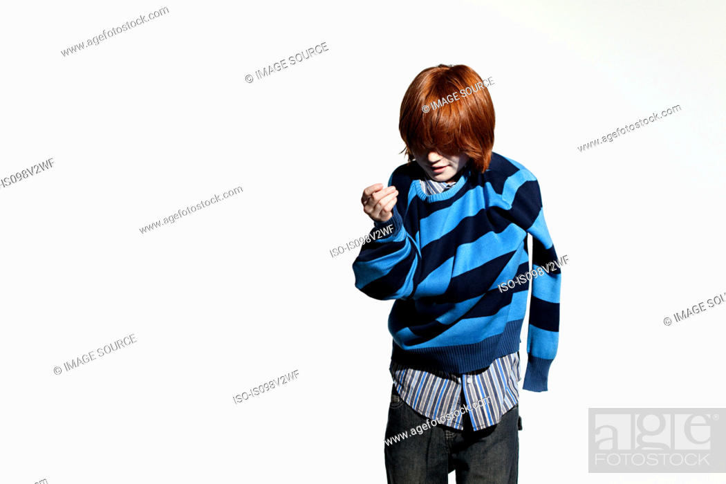 Stock Photo: Boy taking off his sweater.