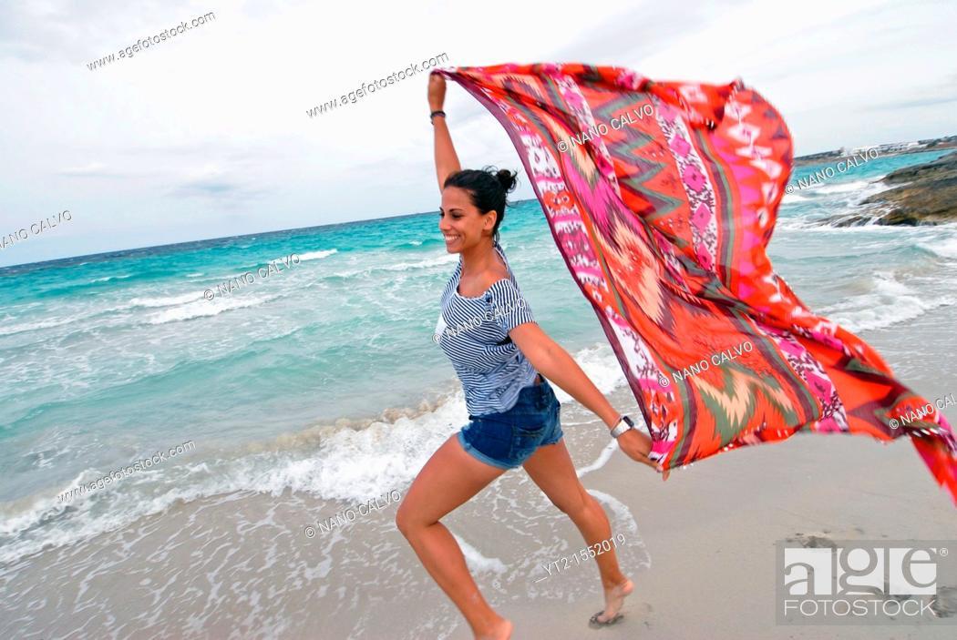 Stock Photo: Young woman enjoying the beach, Formentera.