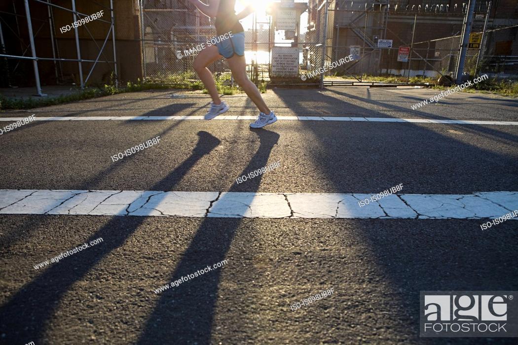 Stock Photo: Woman running on road.
