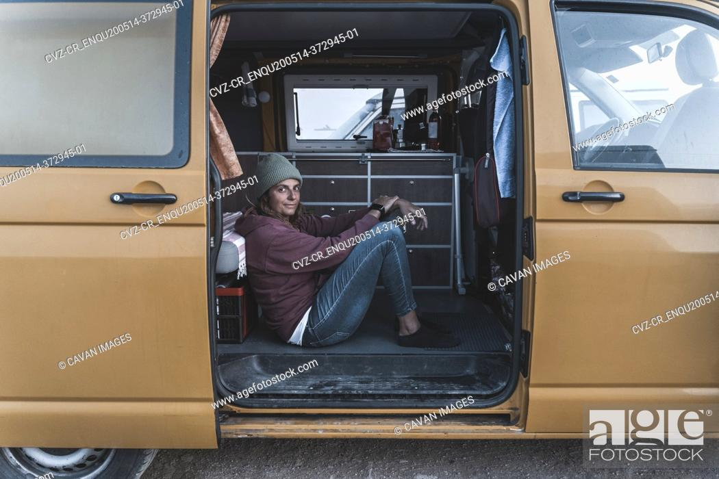 Stock Photo: Surfing girl lifestyle in her van.