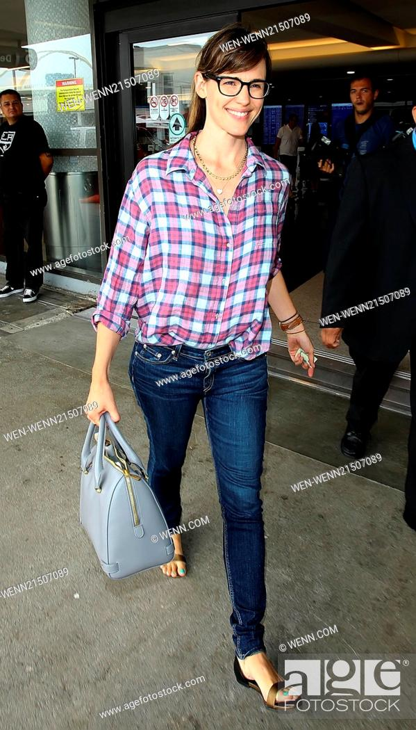 6e34972f46 Stock Photo - Jennifer Garner arrives at Los Angeles International Airport ( LAX) wearing a plaid button down shirt and skinny jeans Featuring  Jennifer  ...