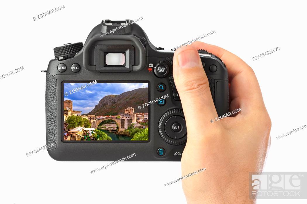 Photo de stock: Hand with camera and Mostar - Bosnia and Herzegovina image (my photo) isolated on white background.