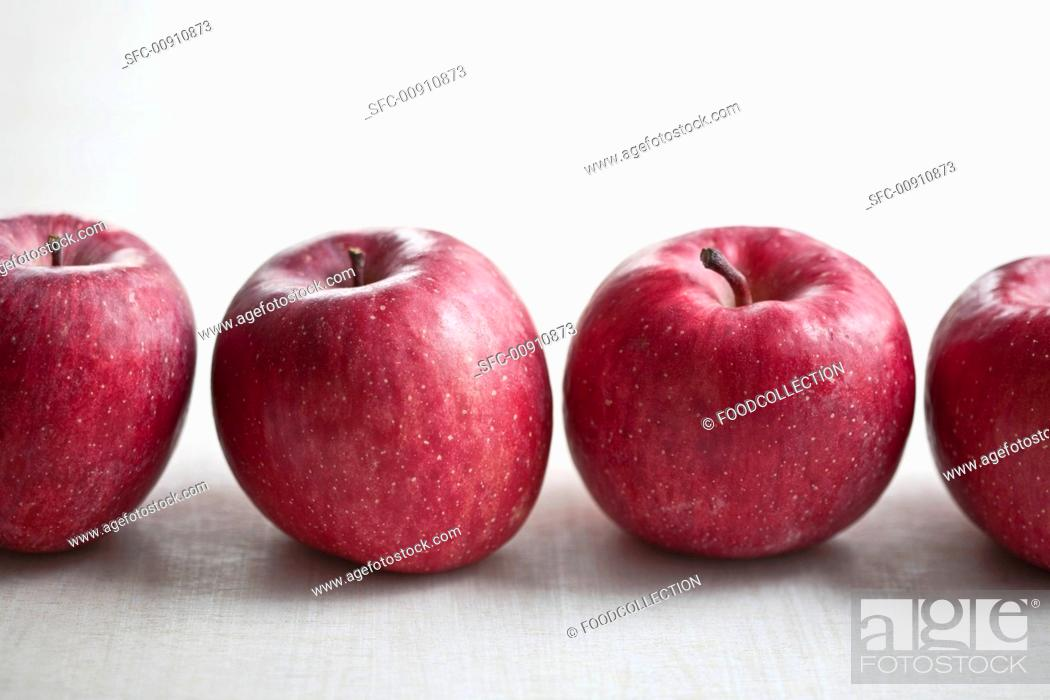 Stock Photo: A row of red apples.