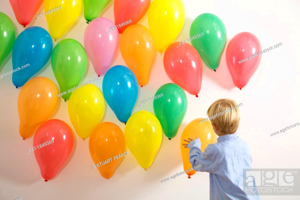 Stock Photo: Children playing with balloons.