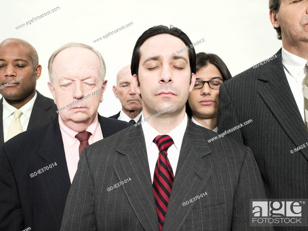 Stock Photo: Businessmen with eyes closed.