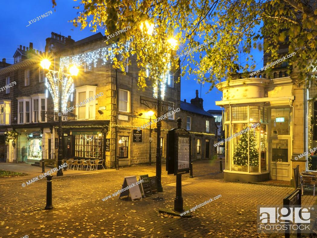 Stock Photo: Autumn leaves and Christmas lights in the Montpellier Quarter at Harrogate North Yorkshire England.