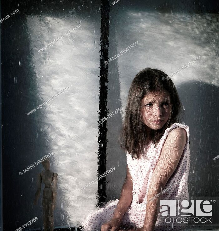 Stock Photo: Girl by the window, looking at the heavy rain outside.