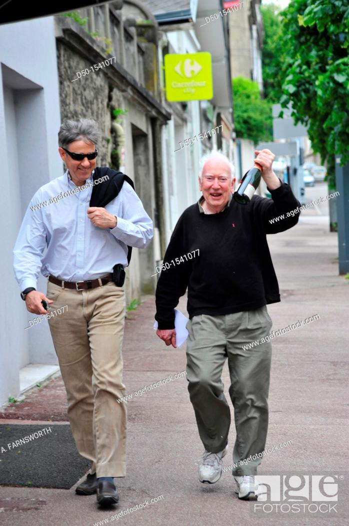 Stock Photo: 80 year old man with 50 year old son on their way to a celebration, Limoges, France.
