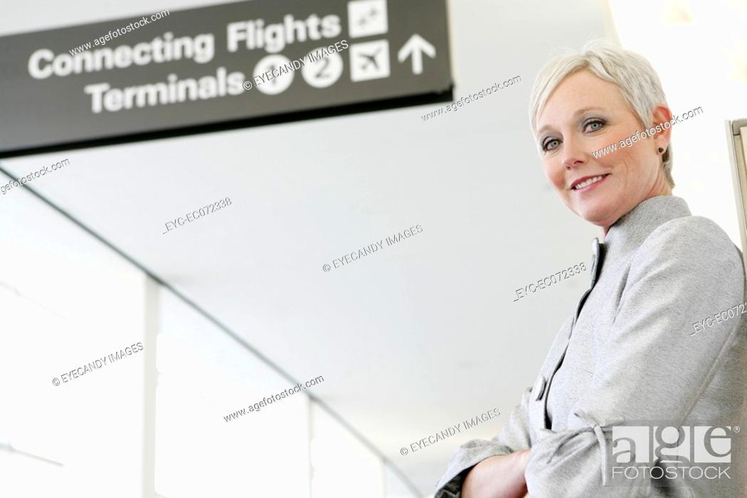 Stock Photo: Portrait of mature woman in airport.