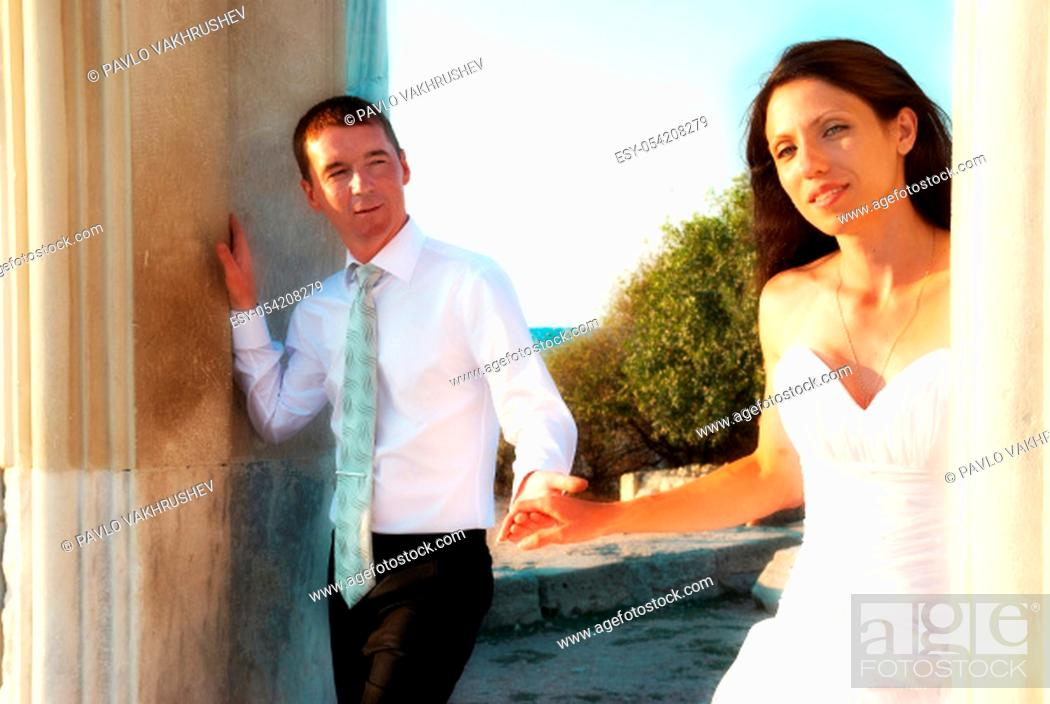 Imagen: Beautiful wedding couple - bride and groom in the greece ancient city.