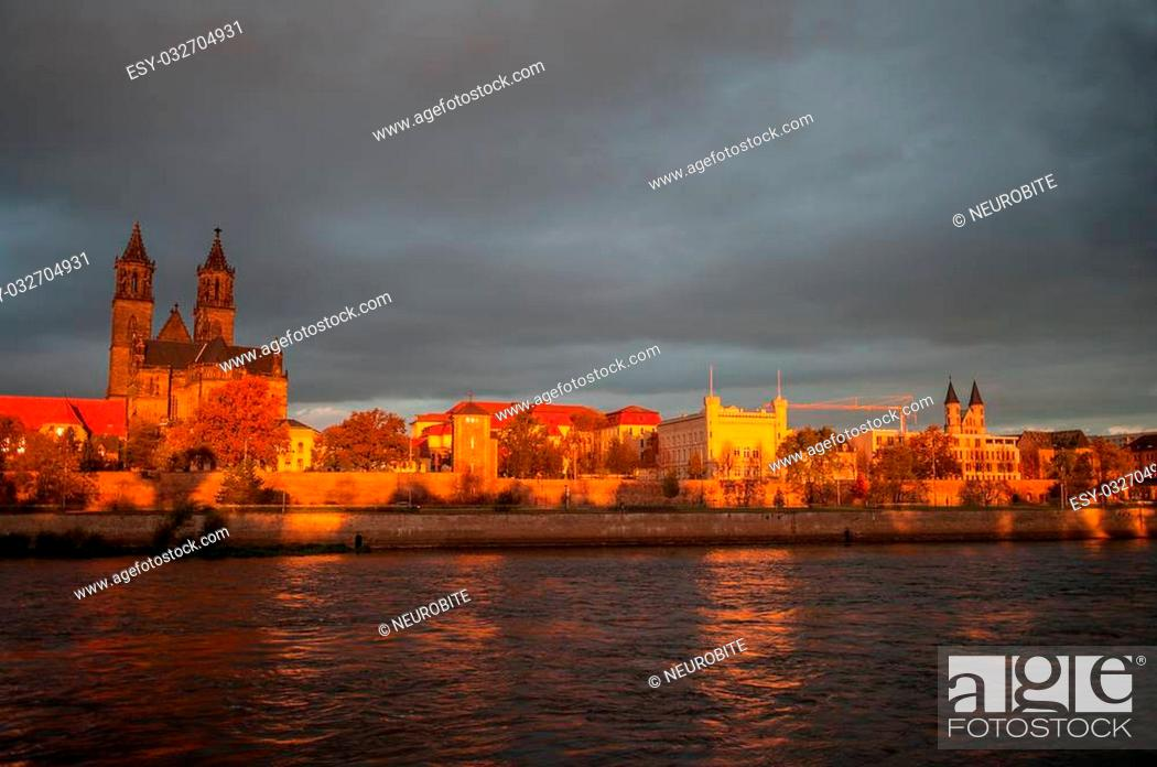 Stock Photo: Golden Cathedral of Magdeburg and the river Elbe at sunrise, Autumn 2013.