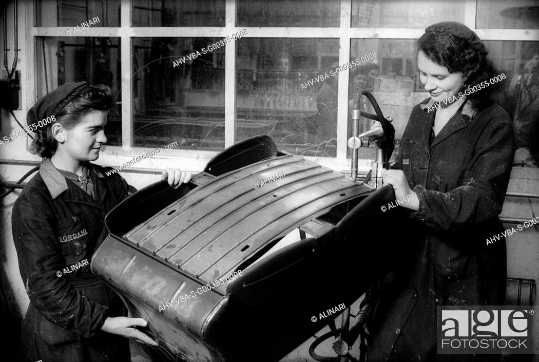 Stock Photo: Two female workers at work in the Giordani company, producer of baby carriages and bicycles, shot 1930 ca. by Villani, Studio.