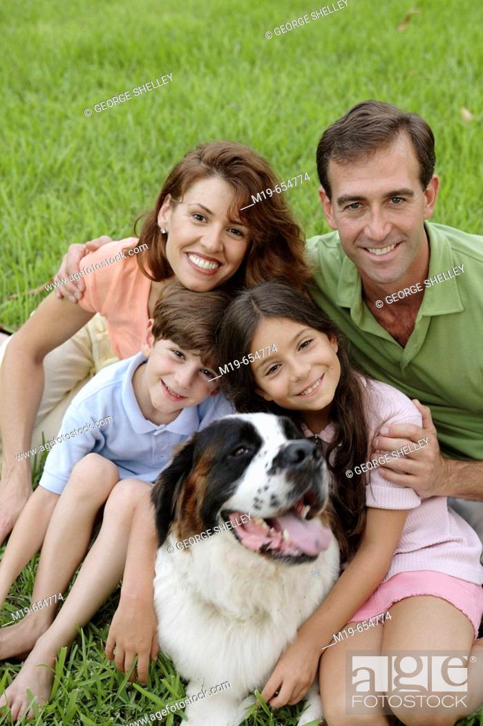 Stock Photo: Happy family with their pet dog.