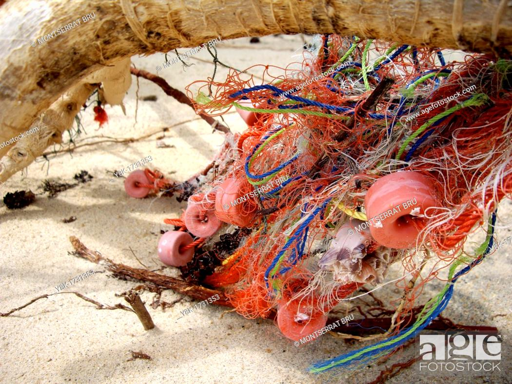 Stock Photo: Fishing net with floaters tangled on tree branch at Ban Tai beach, Koh Phangan, Thailand.