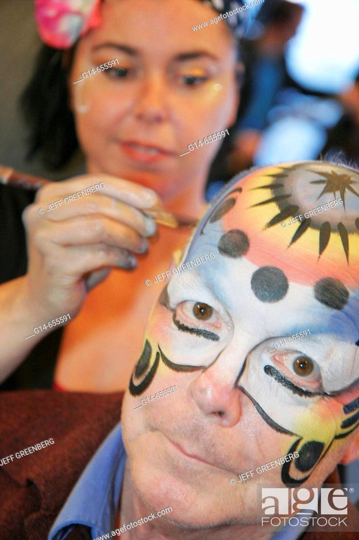 Imagen: Canada, Quebec City, Upper Town, Hilton Hotel, reception, party, painted faces, female artist, senior male,.