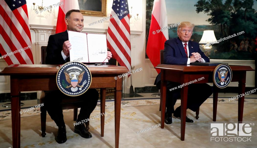 Stock Photo: US President Donald J. Trump (R) and Polish President Andrzej Duda (L) participate in a signing ceremony in the Diplomatic Reception Room of the White House in.