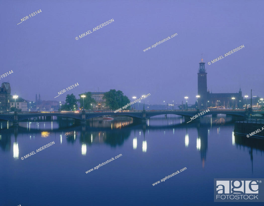 Stock Photo: A luminous bridge over smooth water.