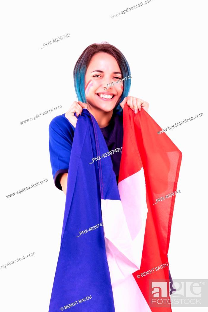 Stock Photo: Portrait of a young supporter of the France football team, the national flag in her hands.