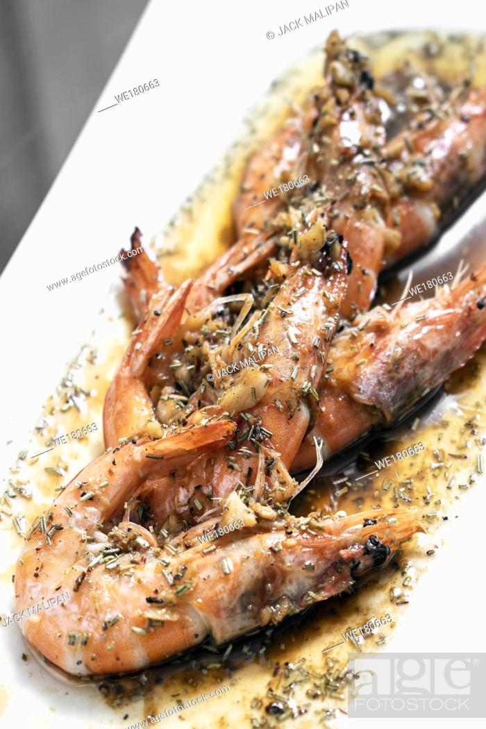 Stock Photo: prawns sauteed with garlic herb and balsamic vinegar sauce in sicily seafood restaurant.