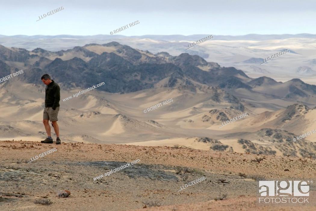 Stock Photo: Lone Male Tourist on a Desert Safari  Skeleton Coast National Park, Kaokoland, Namibia, Africa.