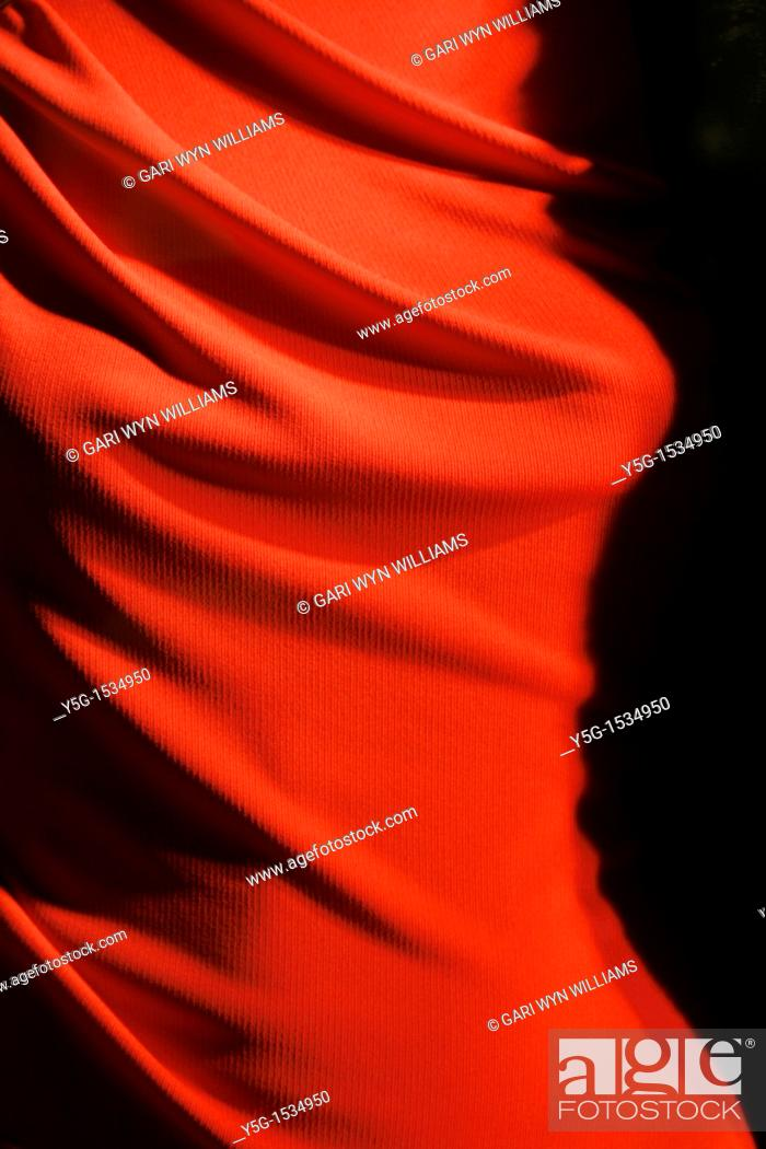 Stock Photo: detail of red dress in shop window on via condotti street rome.
