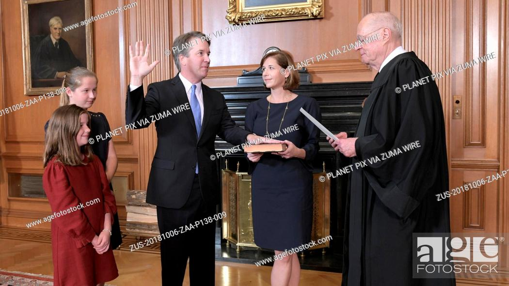 Stock Photo: October 6, 2018 - Washington, DC, United States of America - Retired Justice Anthony Kennedy administers the oath of office to Judge Brett Kavanaugh in the.