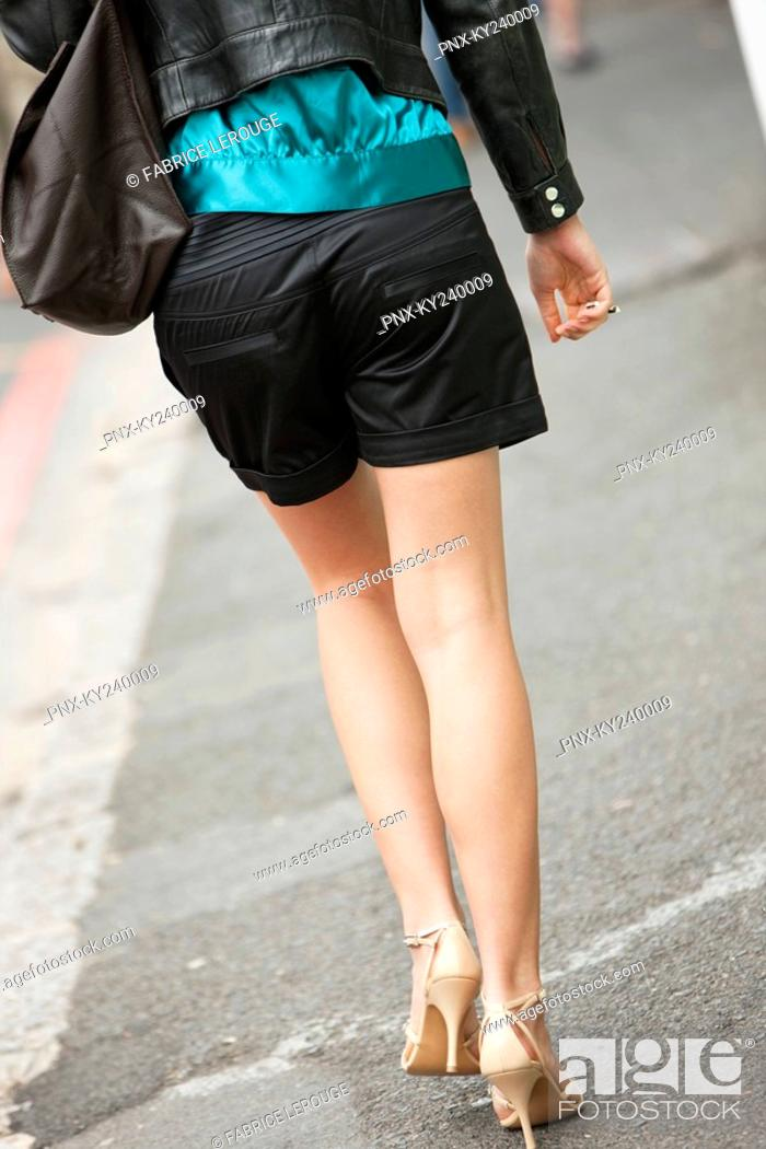 Stock Photo: Rear view of a woman walking on the road.