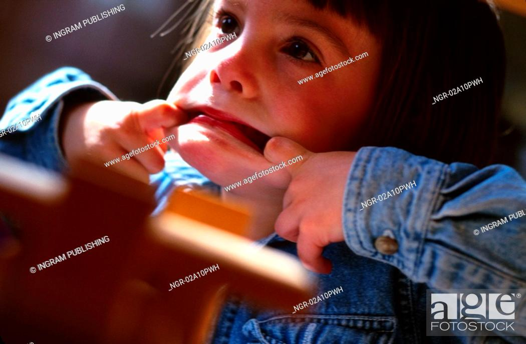 Stock Photo: little girl making faces.