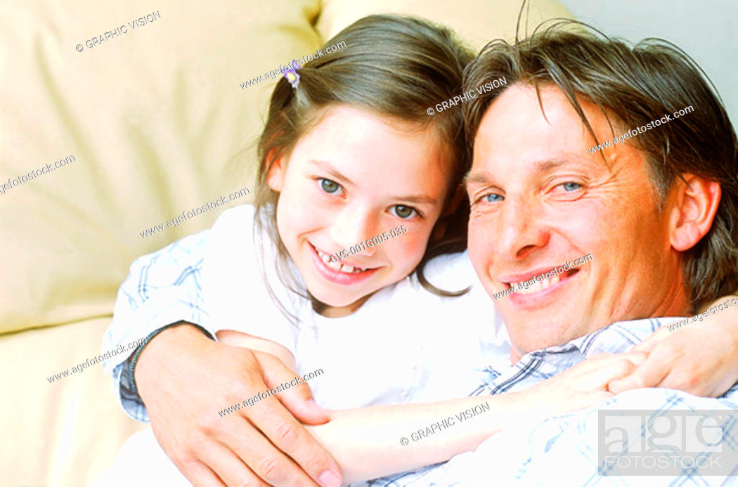 Stock Photo: Portrait of a father holding his daughter.