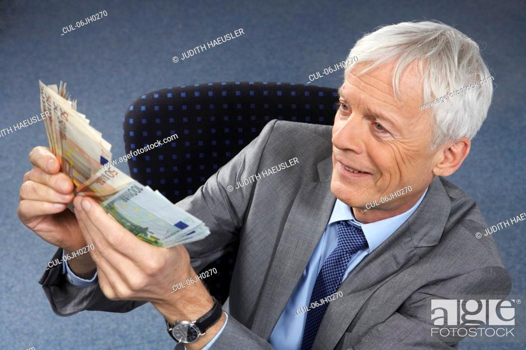 Stock Photo: Businessman with lots of money in hands.