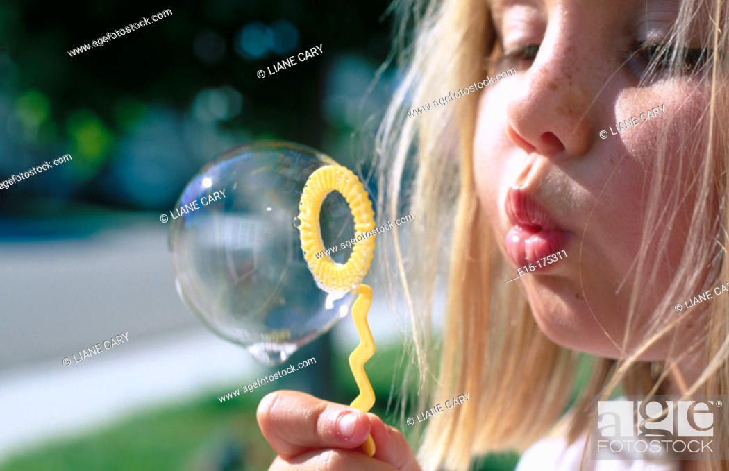 Stock Photo: Girl blowing bubble.