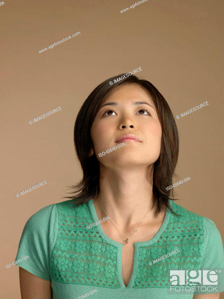 Stock Photo: Woman looking up.