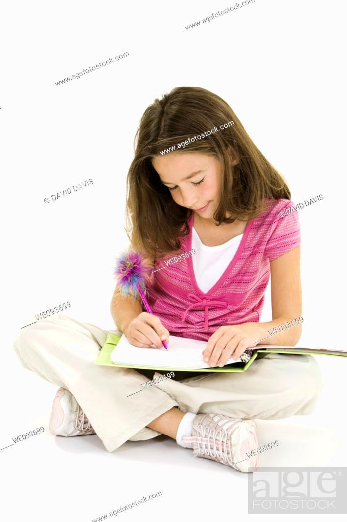 Stock Photo: Child working on homework on white background.