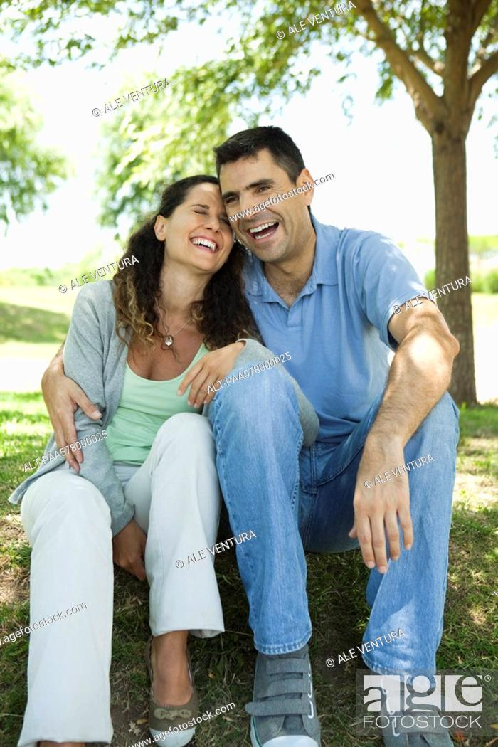Stock Photo: Couple laughing together outdoors.